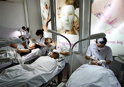 Women receive cosmetic beauty treatments